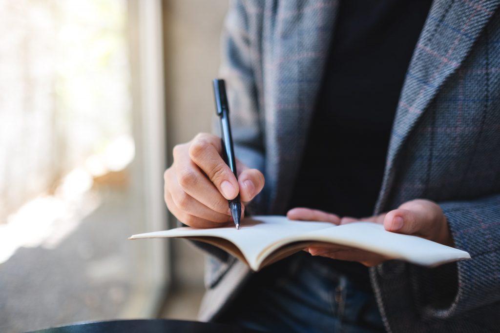 notebook man writing
