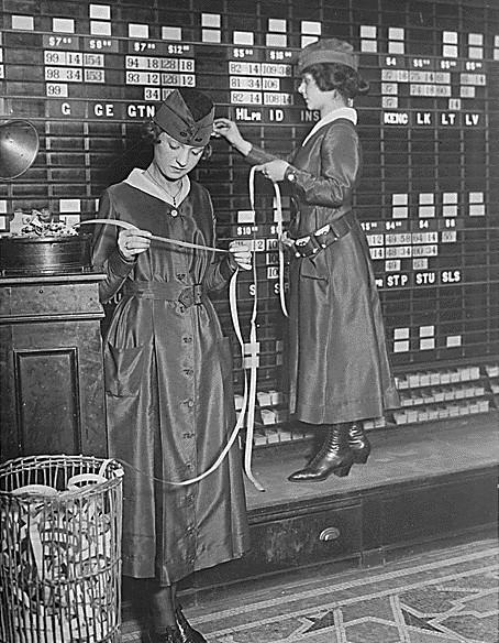 women sorting computer information