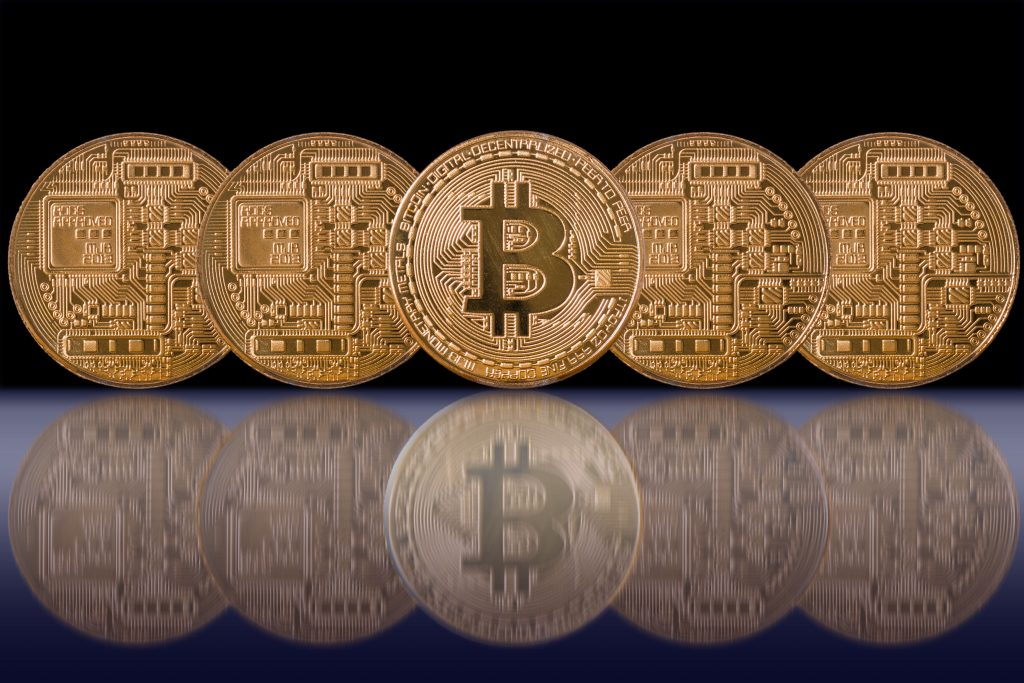 Closeup Five Bitcoins mockup with reflection on black color back